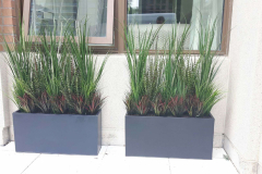 Artificial grass arrangements on a ground level condo terrace in mid-town Toronto