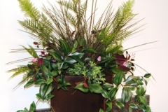 Mixed silk tropical plant arrangement used in Toronto office lunchroom